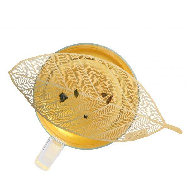Mighty. Fine Tea Filter straining tea leaves on top of a tea cup