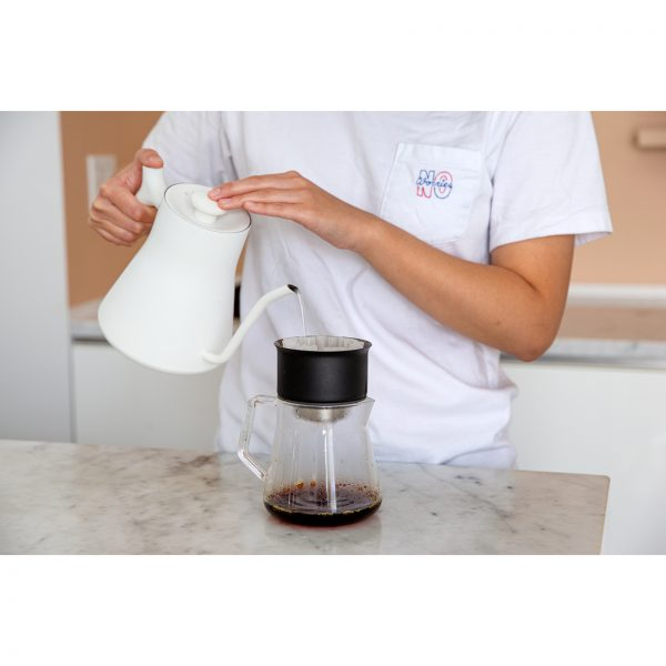 Stagg Pour-Over Kettle pouring water into carafe
