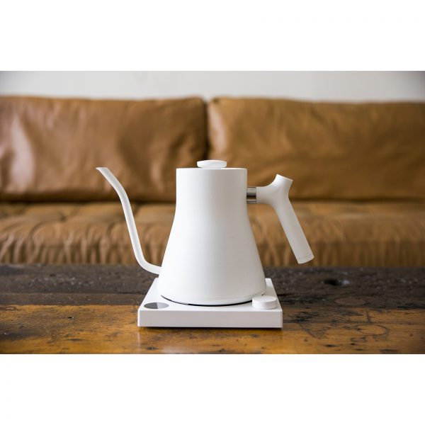 Stagg EKG Kettle w Base on a coffee table